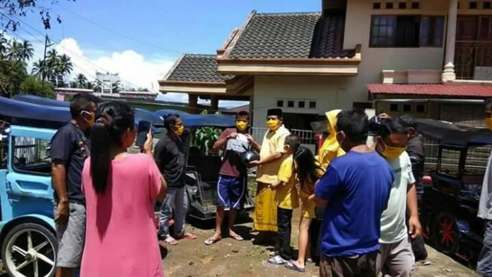 Herdy Korompot Pimpin Fraksi Golkar DPRD Kotamobagu Berbagi Untuk Warga Terdampak Corona